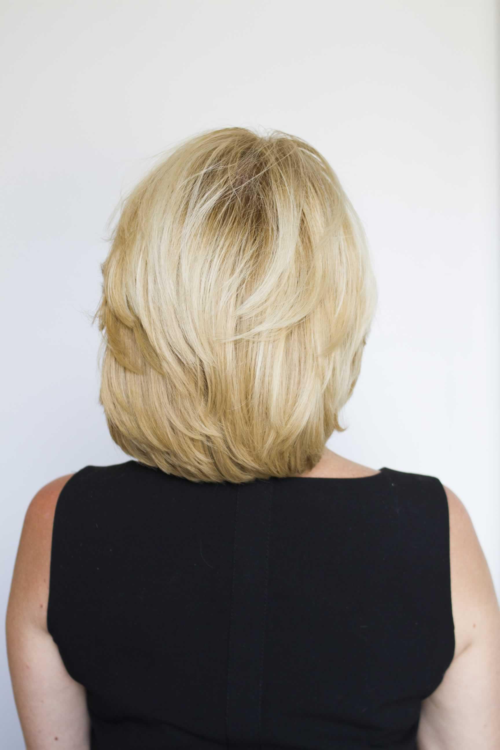 Blonde woman in black shirt