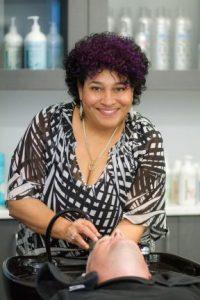 sara pena washing a clients hair